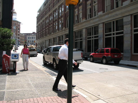 Man stepping onto crosswalk in downtown Chattanooga, TN